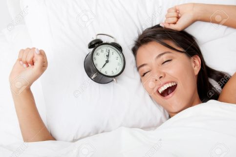 10957241-Time-to-wake-up-for-a-beautiful-woman-sleeping--Stock-Photo
